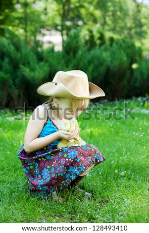 Girls play with chicken and duck - stock photo
