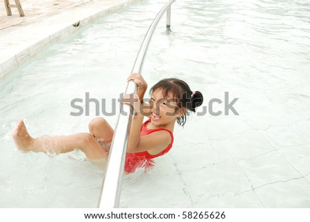 Girls playing in the pool