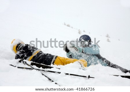 Girls playing in the snow on a skiing trip