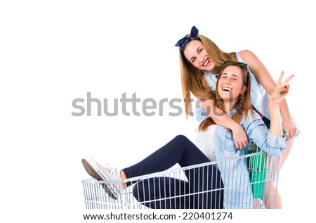 Girls playing with supermarket cart