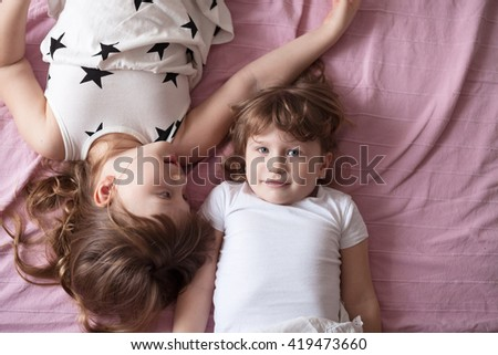 girls sisters siblings play, hug, relationships sisters, close up, domestic real situation, the concept of childhood, lifestyle,