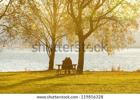 Girls sitting on a bench - stock photo