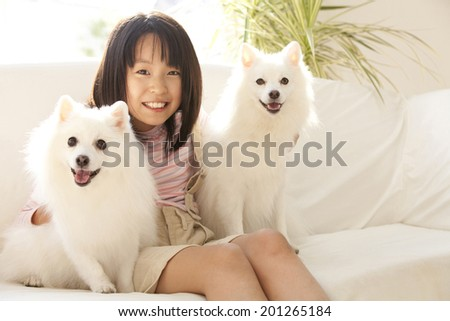 Girls smiling and two Spitz dogs