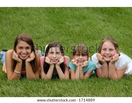 Girls Smiling with Chin in Hands