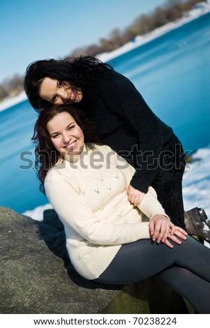 Girls twins near river in winter - stock photo