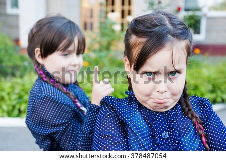 Girls twins near school conflict - stock photo