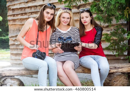 Girls using a tablet pc sitting