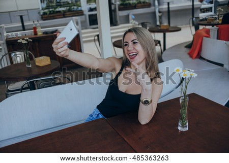 Girls walking around town, sit in cafes and pictures on phones