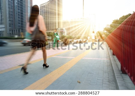 Girls walking to work in Guangzhou, China