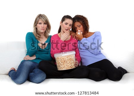 Girls watching a sad film - stock photo