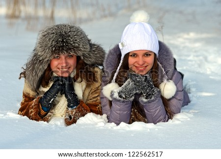 Girls winter fun in the park