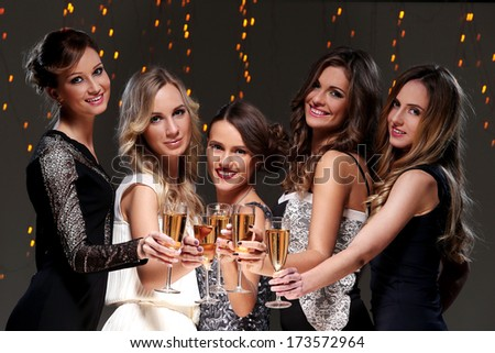 Girls with a glass of champagne have new year party - stock photo