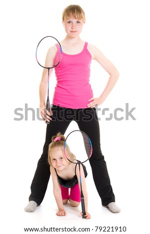 Girls with a rackets on a white background. - stock photo