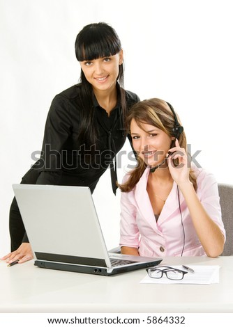 girls with headset and laptop at call center - stock photo