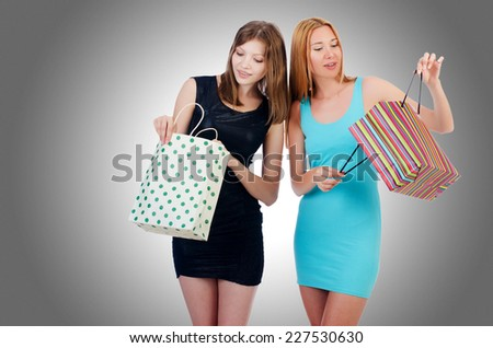 Girls with shopping bags on white - stock photo