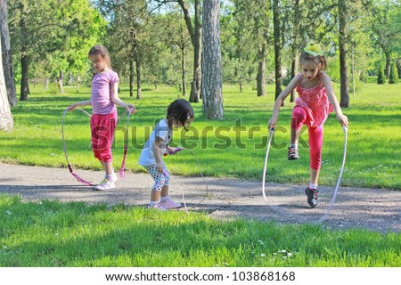 Girls with skipping rope - stock photo