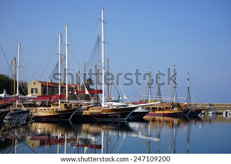 GIRNE, NORTH CYPRUS - CIRCA JANUARY 2015 Boats near old custom house in old port                                - stock photo