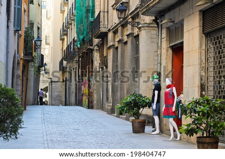 GIRONA, SPAIN - APRIL 9, 2014: Mannequins in the door of a clothing store in one of the streets of the historic town of Girona.