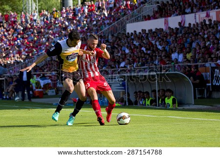 GIRONA, SPAIN - JUNE 7: David Junca (R) of Girona in action at the Spanish Second Division League match between Girona FC and CD Lugo, final score 1 - 1, on June 7, 2015, in Girona, Spain. - stock photo