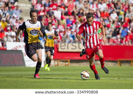 GIRONA, SPAIN - JUNE 7: Eloi Amagat of Girona in action at the Spanish Second Division League match between Girona FC and CD Lugo, final score 1 - 1, on June 7, 2015, in Girona, Spain. - stock photo