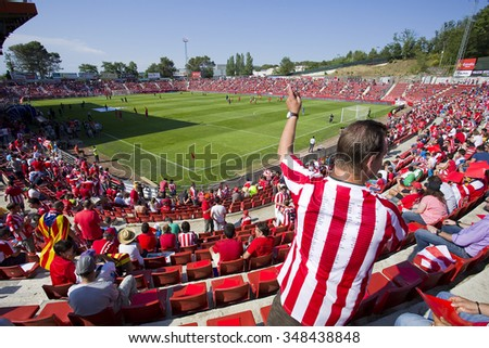 GIRONA, SPAIN - JUNE 7: People in Montilivi stadium before the Spanish Second Division League match between Girona FC and CD Lugo, final score 1 - 1, on June 7, 2015, in Girona, Spain. - stock photo