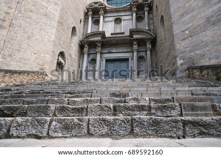 GIRONA, SPAIN - 29 JUNE 2017 - Staircase and facade of Sant Feliu. Girona's first cathedral and the location of the shooting of the 6th season of  Game of the thrones in Girona, Catalonia, Spain
