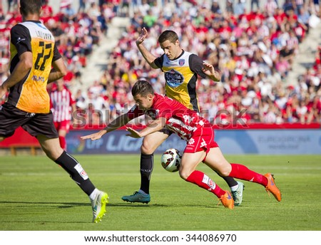 GIRONA, SPAIN - JUNE 7: Unidentified players in action at the Spanish Second Division League match between Girona FC and CD Lugo, final score 1 - 1, on June 7, 2015, in Girona, Spain. - stock photo