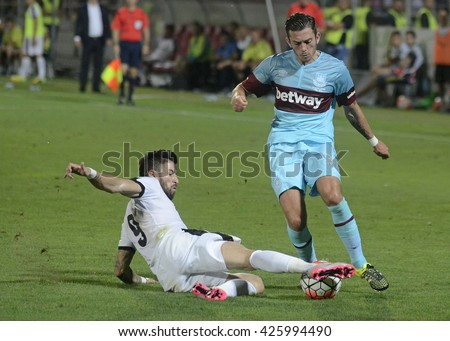 GIURGIU, ROMANIA - AUGUST 6, 2015: Gabriel Enache and Lewis Page pictured during the UEFA Europa League game between Astra Giurgiu and West Ham United, at Marin Anastasovici stadium.