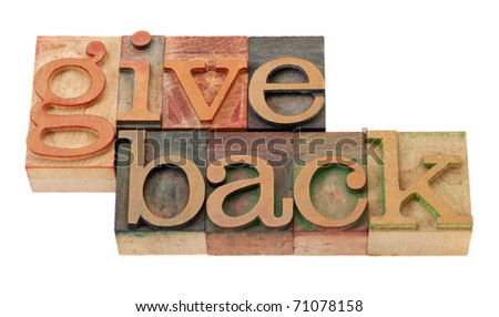 give back - words in vintage wooden letterpress printing blocks, stained by color inks, isolated on white - stock photo