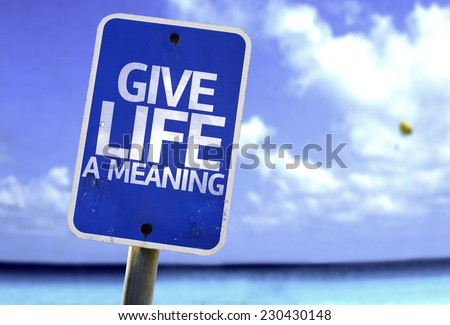 Give Life a Meaning sign with a beach on background - stock photo