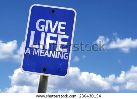 Give Life a Meaning sign with a beach on background