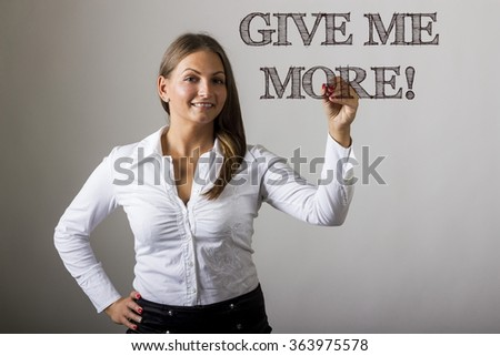 GIVE ME MORE! - Beautiful girl writing on transparent surface - horizontal image