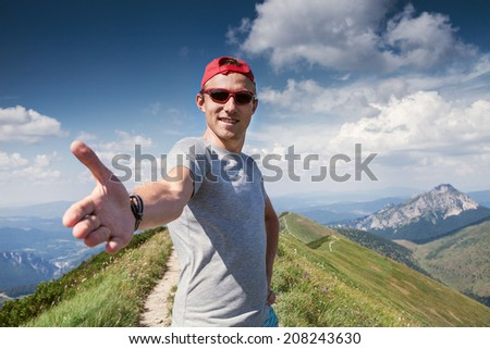 Give me your hand and Come with me in mountain walk - stock photo