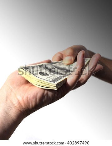 Give money to someone (concept of bribe/corruption) - stock photo