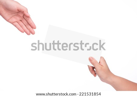 Give someone money in envelop for corruption purposes.female hands passing exchange letter in envelope. isolated on white - stock photo