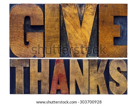 give thanks - Thanksgiving concept - isolated word abstract act in letterpress wood type with ink patina - stock photo