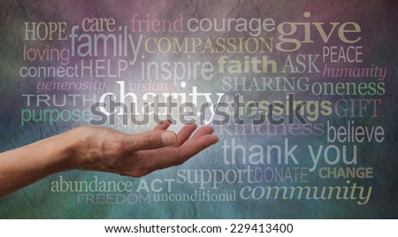 Give to Charity Banner - Woman's outstretched open hand with the word 'charity' in white above palm, surrounded by charity related words on a rustic blue and purple stone effect background  - stock photo