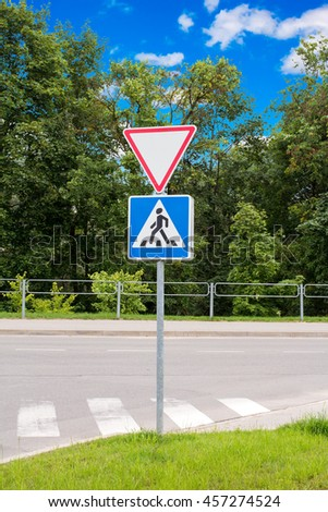 Give way and cross road sign in the residential area - stock photo