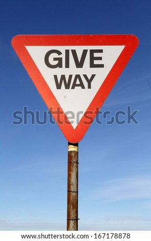 Give Way Sign Against A Blue Sky  - stock photo