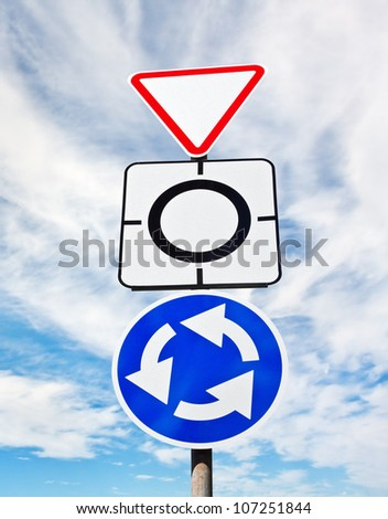 Give way sign with traffic circle - stock photo