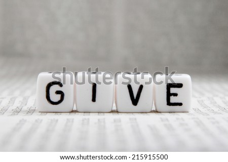 give word on white cube - stock photo