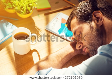 Giving all his energy to work. Close-up top view of tired man sleeping while sitting at his working place  - stock photo