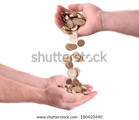 giving and receiving money falling from one hand to another isolated on a white background  - stock photo