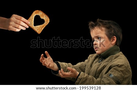 Giving food to the needy - sharing with the less fortunate - stock photo