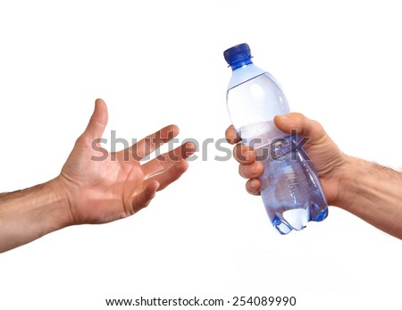Giving mineral water bottle - stock photo
