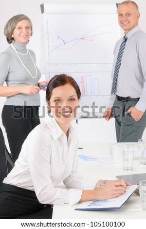 Giving presentation young executive during meeting woman review charts