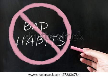 Giving up  bad habits words and symbol on the blackboard using chalk - stock photo