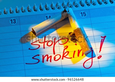 giving up smoking. good resolution in the calendar to be non smoking. - stock photo