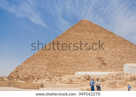 Giza, Cairo, Egypt - June 03, 2010 :: Arabic people near the ancient pyramids of Giza in a desert of Egypt.