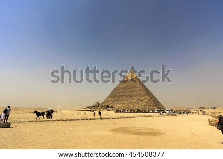 GIZA, EGYPT - MAY 18: Both tourists and locals visit the Pyramids and Sphinx on May 18, 2009, at Giza, Egypt. The world's oldest tourist attraction, the Pyramids of Giza are 5000 years old.